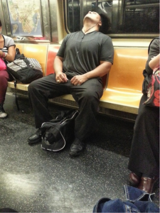 There is a woman in this picture taking up literally twice as much space as this man.